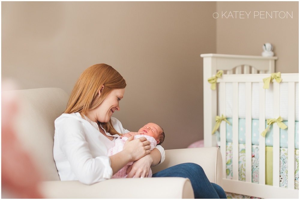 Mom and newborn baby girl in nursery, Atlanta lifestyle newborn session